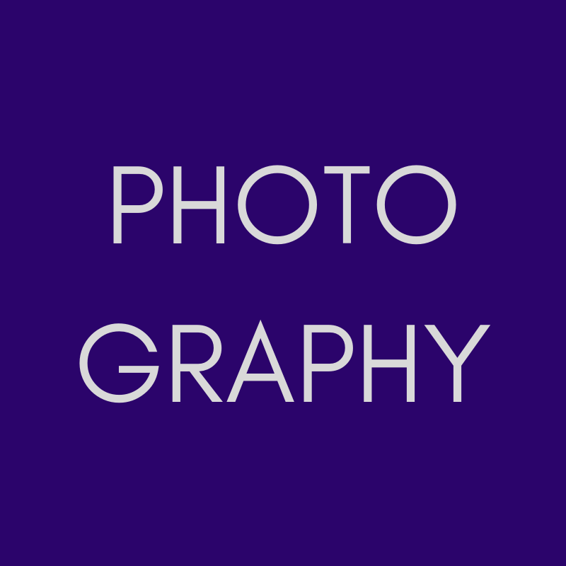 """""""PHOTOGRAPHY"""" in pale grey on a purple background."""