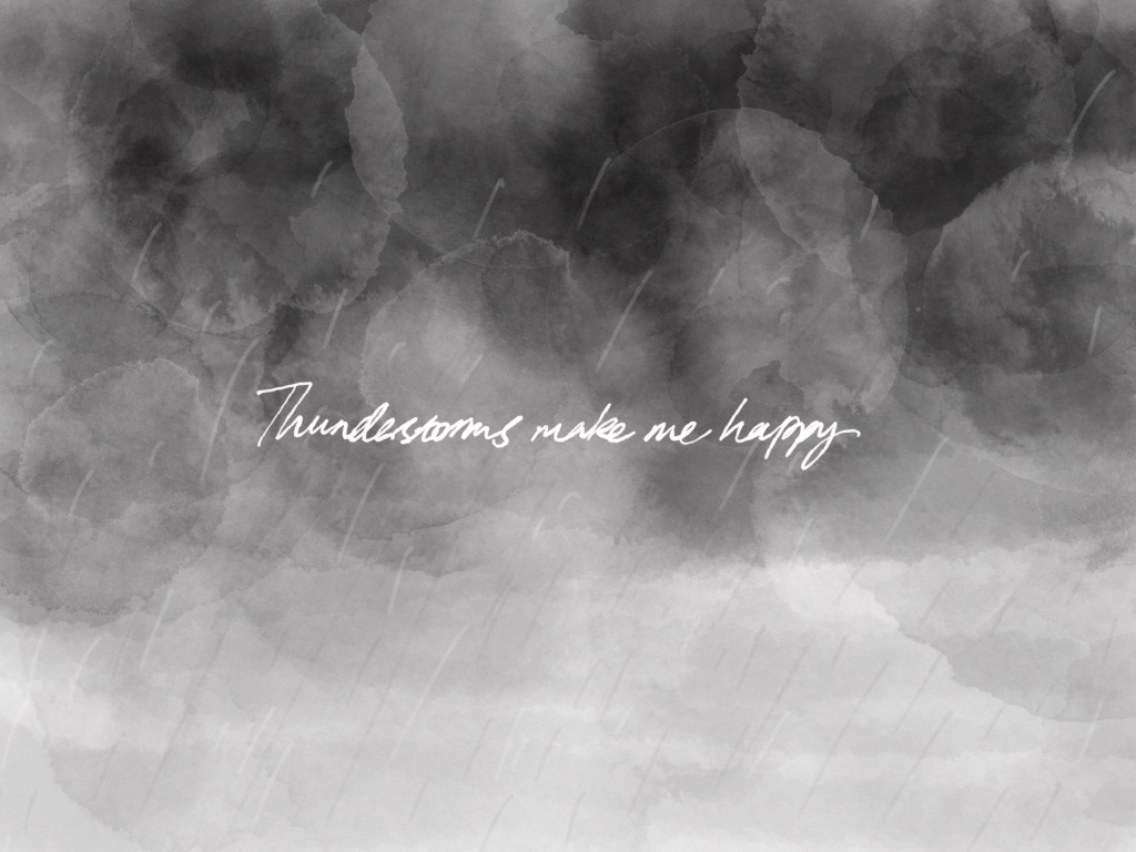 """""""Thunderstorms make me happy"""" written in white over a layered watercolour background that looks like a stormfront sky."""